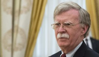 In this Wednesday, June 27, 2018, file photo, U.S. National security adviser John Bolton waits for the talks with Russian President Vladimir Putin in the Kremlin in Moscow, Russia. (AP Photo/Alexander Zemlianichenko, Pool) ** FILE **