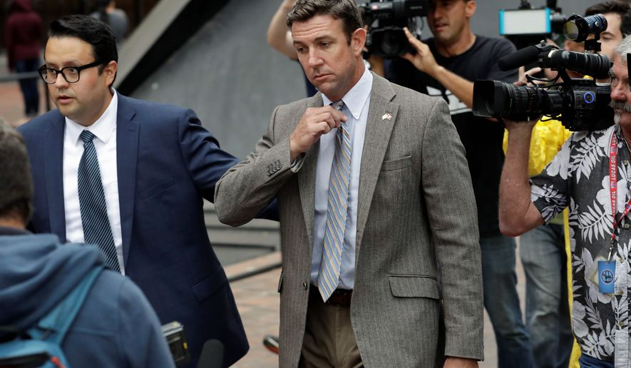 Reps Rep. Chris Collins, New York Republican, (left) and Duncan Hunter, California Republican, are likely weeks from winning re-election. Both were indicted a few months ago. (Associated Press photographs)