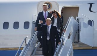 President Donald Trump arrives with Sen. Dean Heller, R-Nev., and his wife Lynne Heller on Air Force One at Elko Regional Airport, Saturday, Oct. 20, 2018, in Elko, Nev., for a campaign rally. (AP Photo/Carolyn Kaster)