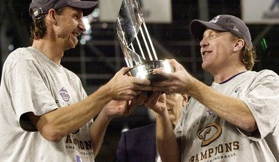 6. Randy Johnson and Curt Schilling, Arizona Diamondbacks (2001) combined to allow six runs over 38.2 innings with 45 strikeouts and five walks. Johnson entered Game 7 in the eighth after pitching 7 innings the game before. Schilling made two of three stellar starts on short rest. Together, they dismantled the Yankees dynasty.  Arizona Diamondbacks pitcher Randy Johnson, left, and Curt Schilling, right, hold the World Series MVP trophy they will share after being named co-receipiants of the World Series Most Valuable Player award after the Diamondbacks beat the New York Yankees 3-2 in Game 7 of the World Series Sunday, Nov. 4, 2001, at Bank One Ballpark in Phoenix. (AP Photo/David J. Phillip)