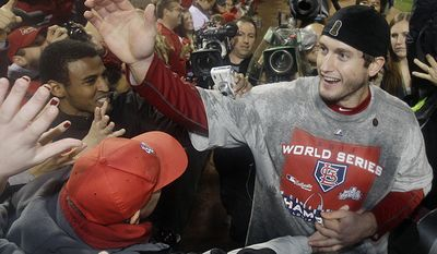 7. David Freese, St. Louis Cardinals (2011) earned MVP honors for saving the series twice. The Texas Rangers had the Cardinals down to its final strike in Game 6. Facing elimination, the third baseman tied it with a triple off the right-field wall. After each team scored two runs in the 10th, Freese blasted a walk-off homer in the 11th. Freese started Game 7 with a two-run double in the opening frame. He finished with three doubles, a triple, a home run, five walks and a 1.160 OPS.  St. Louis Cardinals' David Freese celebrates after Game 7 of baseball's World Series against the Texas Rangers Friday, Oct. 28, 2011, in St. Louis. The Cardinals won 6-2 to win the series. (AP Photo/Matt Slocum)
