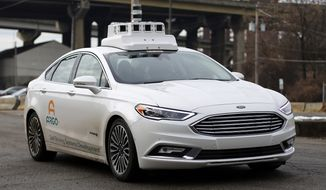 An Argo self-driving car is tested on the Northside of Pittsburgh Monday, Jan. 22, 2018. Argo is a company owned by Ford. (AP Photo/Gene J. Puskar)