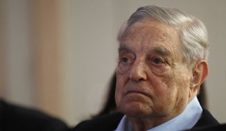 "George Soros, founder and chairman of the Open Society Foundations listens to the conference after his speech entitled ""How to save the European Union"" as he attends the European Council On Foreign Relations Annual Council Meeting in Paris, Tuesday, May 29, 2018. (AP Photo/Francois Mori) ** FILE **"