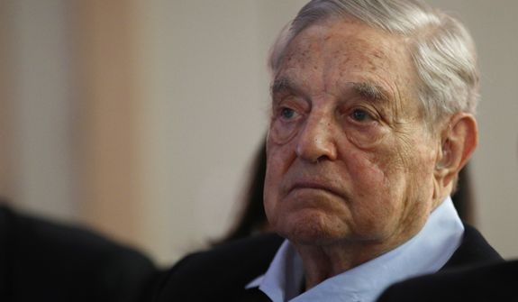 """George Soros, Founder and Chairman of the Open Society Foundations listens to the conference after his speech entitled """"How to save the European Union"""" as he attends the European Council On Foreign Relations Annual Council Meeting in Paris, Tuesday, May 29, 2018. (AP Photo/Francois Mori)"""