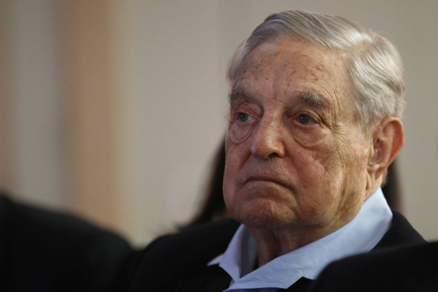 """George Soros, founder and chairman of the Open Society Foundations listens to the conference after his speech entitled """"How to save the European Union"""" as he attends the European Council On Foreign Relations Annual Council Meeting in Paris, Tuesday, May 29, 2018. (AP Photo/Francois Mori) ** FILE **"""
