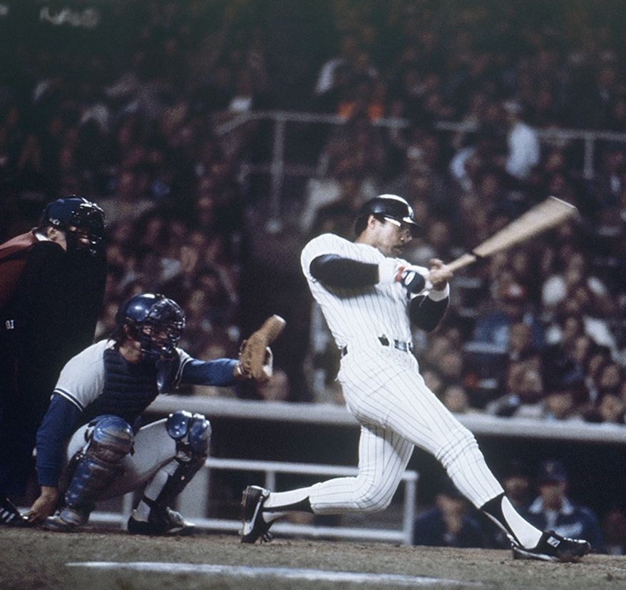 5. Reggie Jackson (1977), New York trailed 3-2 in Game 6's fourth inning when Mr. October sent a three-run shot out of the park. He put the game out of reach with another shot the following frame before capping off the historic game with an eighth-inning blast. He finished the series with nine hits, three walks, 10 runs, eight RBI and five homers.  New York Yankee Reggie Jackson blasts home run number three during the sixth and final game of the World Series at Yankee Stadium in New York on Oct. 18, 1977. (AP Photo)