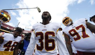 Washington Redskins free safety D.J. Swearinger (36) speaks to the team in a huddle before an NFL football game against the Dallas Cowboys, Sunday, Oct. 21, 2018, in Landover, Md. (AP Photo/Alex Brandon) ** FILE **