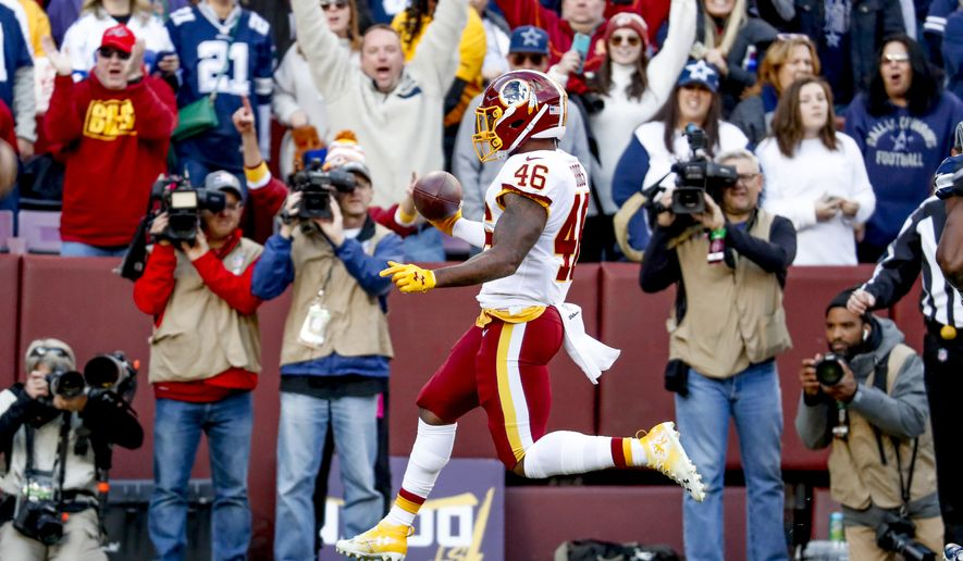Washington Redskins running back Kapri Bibbs (46) scores a touchdown in the first quarter of an NFL football game, Sunday, Oct. 21, 2018, in Landover, Md. The Redskins defeated the Cowboys 20-17. (AP Photo/Andrew Harnik)