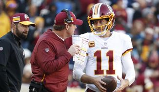 Washington Redskins head coach Jay Gruden speaks with Washington Redskins quarterback Alex Smith (11) in the second quarter of an NFL football game against the Dallas Cowboys, Sunday, Oct. 21, 2018, in Landover, Md. The Redskins defeated the Cowboys 20-17. (AP Photo/Andrew Harnik) ** FILE **