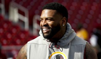 Washington Redskins offensive tackle Trent Williams (71) takes the field for warms up before an NFL football game against the Dallas Cowboys Sunday, Oct. 21, 2018, in Landover, Md. (AP Photo/Andrew Harnik) **FILE**