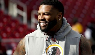 Washington Redskins offensive tackle Trent Williams (71) takes the field for warms up before an NFL football game against the Dallas Cowboys Sunday, Oct. 21, 2018, in Landover, Md. (AP Photo/Andrew Harnik)