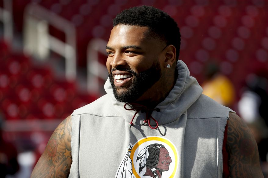 Washington Redskins offensive tackle Trent Williams (71) takes the field for warms up before an NFL football game against the Dallas Cowboys Sunday, Oct. 21, 2018, in Landover, Md. (AP Photo/Andrew Harnik) ** FILE **
