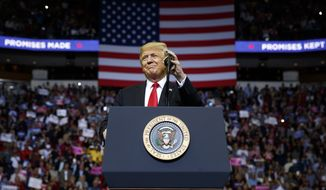 President Donald Trump arrives for a campaign rally for Sen. Ted Cruz, R-Texas, at Houston Toyota Center, Monday, Oct. 22, 2018, in Houston. (AP Photo/Evan Vucci)