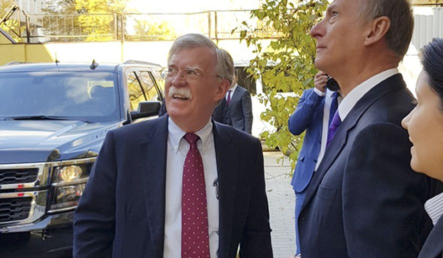U.S. National Security Adviser John Bolton, left, and Russian Security Council chairman Nikolai Patrushev talk prior their official talks in Moscow, Russia, Monday, Oct. 22, 2018. Bolton met with Patrushev to discuss a broad range of issues including arms control agreements, Syria, Iran, North Korea and the fight against terrorism.(Press Service of the Russian Security Council via AP)