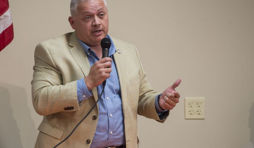 Denver Riggleman, a Republican candidate for Virginia's 5th District, speaks during a forum at the Lynchburg Regional Business Alliance in Lynchburg, Va., Monday, Oct. 22, 2018. (Taylor Irby/The News & Advance via AP) ** FILE **