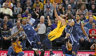 Utah Jazz guard Ricky Rubio (3) shoots as Memphis Grizzlies' MarShon Brooks (8) and Garrett Temple (17) defend in the first half during an NBA basketball game Monday, Oct. 22, 2018, in Salt Lake City. (AP Photo/Rick Bowmer)