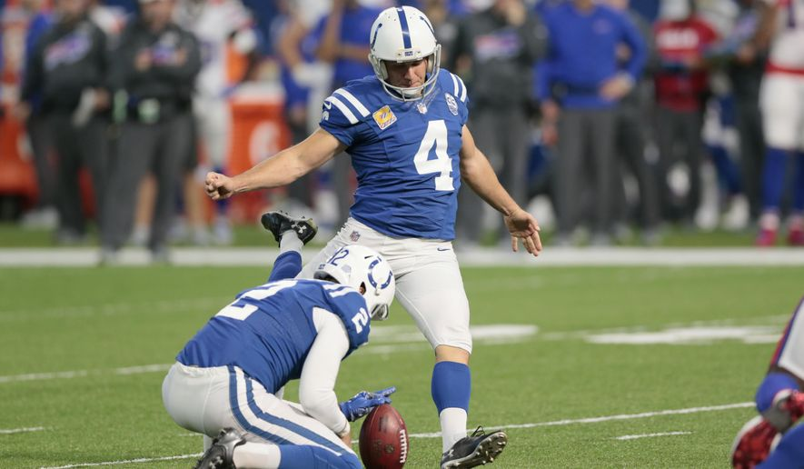 Indianapolis Colts kicker Adam Vinatieri (4) misses an extra point from he hold of Rigoberto Sanchez during the second half of an NFL football game against the Buffalo Bills in Indianapolis, Sunday, Oct. 21, 2018. (AP Photo/AJ Mast)