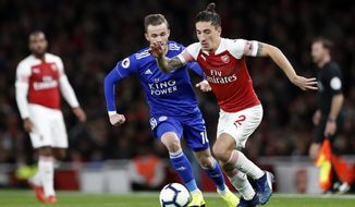 Leicester City's James Madison, left, vies for the ball with Arsenal's Hector Bellerin during the English Premier League soccer match between Arsenal and Leicester City at the Emirates stadium in London, Monday, Oct. 22, 2018. (AP Photo/Alastair Grant)