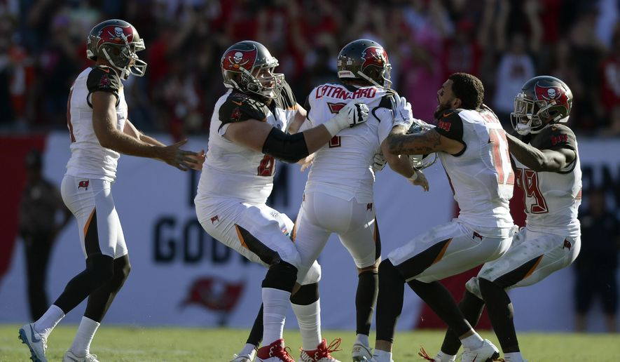 Tampa Bay Buccaneers kicker Chandler Catanzaro (7) celebrates with teammates after his game-winning 59-yard field goal in overtime of an NFL football game Sunday, Oct. 21, 2018, in Tampa, Fla. (AP Photo/Jason Behnken)