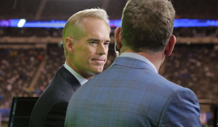 Joe Buck, left, talks to Troy Aikman before an NFL football game between the New York Giants and the Philadelphia Eagles on Thursday, Oct. 11, 2018, in East Rutherford, N.J. The World Series comes in the midst of the busiest month of Buck's 25-year career at Fox. He normally does only baseball once the League Championship Series begin, but he has added Thursday Night Football to his schedule. If the World Series does go the distance, Buck will be doing 18 games over a 22-day stretch. Buck said that it is grind he is used to from his years doing St. Louis Cardinals baseball games on radio and television. (AP Photo/Frank Franklin II) ** FILE **