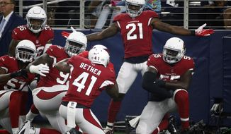 FILE - In this Aug. 26, 2018, file photo, Arizona Cardinals' Patrick Peterson (21) celebrates after scoring a touchdown on an interception during the first half of a preseason NFL football game against the Dallas Cowboys in Arlington, Texas. Cardinals coach Steven Wilks says there is no way star Peterson will be traded, despite a report he has asked to be dealt by the Oct. 30 deadline. (AP Photo/Michael Ainsworth, File)