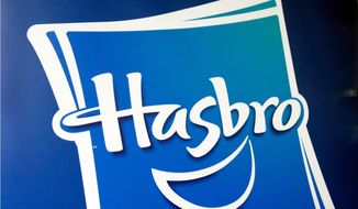 FILE - This April 26, 2018, file photo, shows the Hasbro logo at the TTPM 2018 Spring Showcase, in New York. Hasbro Inc. (HAS) on Monday, Oct. 22, reported third-quarter earnings of $263.9 million. (AP Photo/Richard Drew, File)