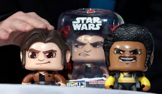 FILE - In this April 26, 2018, file photo, the Star Wars Hans Solo Mighty Muggs, by Hasbro, are demonstrated at the TTPM 2018 Spring Showcase, in New York. Hasbro Inc. (HAS) on Monday, Oct. 22, reported third-quarter earnings of $263.9 million. (AP Photo/Richard Drew, File)