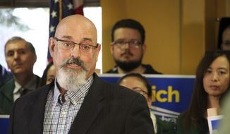 Vince Beltrami, president of the Alaska AFL-CIO, announces the labor organization's support for Democrat Mark Begich over Republican Mike Dunleavy in the Alaska governor's race during a news conference Monday, Oct. 22, 2018, in Anchorage, Alaska. The state's largest labor organization had previously endorsed Gov. Bill Walker, who dropped his re-election plans Oct. 19, 2018. (AP Photo/Mark Thiessen)
