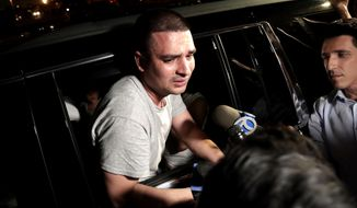 FILE - In this July 24, 2018 file photo, Pablo Villavicencio leans out of an SUV while talking to reporters after being released from the Hudson County Correctional Facility in Kearny, N.J. The Ecuadorian pizza deliveryman who was held up as an example of zealous U.S. immigration enforcement has was arrested Thursday, Oct. 18, 2018 in a domestic violence case. A criminal complaint alleges that Villavicencio pushed his wife against a wall, slapped her and grabbed her phone to keep her from calling police. (AP Photo/Julio Cortez, File)