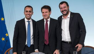Left to right: vice premier Luigi Di Maio, premier Giuseppe Conte and vice premier Matteo Salvini, pose as they arrive for a press conference at Chigi's Palace, in Rome, Saturday, Oct. 20 2018. Italy's government vowed Saturday to engage in constructive talks with the European Union as it still gave final approval to a rule-busting budget and brushed off a ratings downgrade triggered by its higher-than-expected deficit targets. (Angelo Carconi/ANSA via AP)