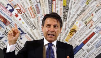 Italian Premier Giuseppe Conte answers reporters' questions during a press conference at the foreign press club in Rome, Monday, Oct. 22, 2018. (AP Photo/Gregorio Borgia)