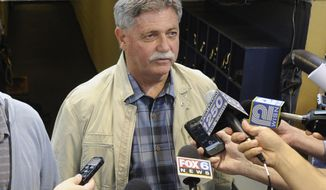 FILE - In this Sept. 27, 2014, file photo, then-Milwaukee Brewers general manager Doug Melvin speaks to the media before a baseball game against the Chicago Cubs in Milwaukee. Melvin is one of three finalists in contention to become general manager of the New York Mets. (AP Photo/Benny Sieu, File)