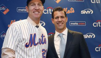 FILE - In this Wednesday, Feb. 7, 2018, file photo, New York Mets newly-signed third baseman Todd Frazier, left, poses for photographers with his agent, Brodie Van Wagenen, after the former New York Yankees third baseman signed with the Mets, in New York. Van Wagenen interviewed Monday, Oct. 22, 2018, to switch sides and become general manager of the New York Mets and is among three finalists along with former Milwaukee GM Doug Melvin and Tampa Bay senior vice president of baseball operations Chaim Bloom. (AP Photo/Kathy Willens, File)