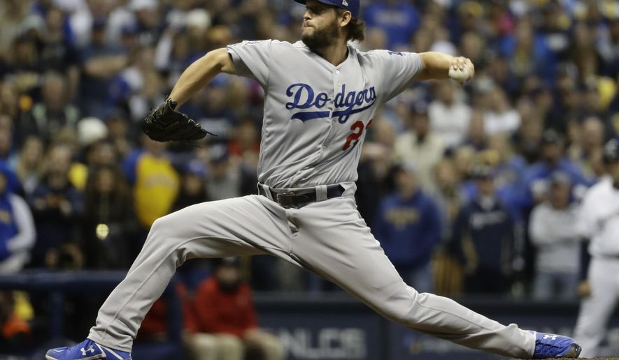 Los Angeles Dodgers' Clayton Kershaw throws during the ninth inning of Game 7 of the National League Championship Series baseball game against the Milwaukee Brewers Saturday, Oct. 20, 2018, in Milwaukee. (AP Photo/Matt Slocum)