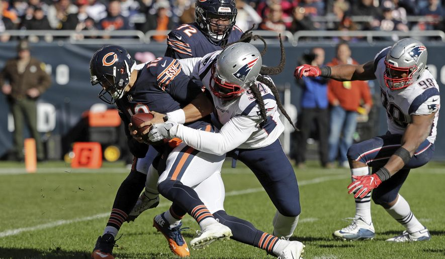 New England Patriots defensive end Adrian Clayborn (94) sacks Chicago Bears quarterback Mitchell Trubisky (10) during the second half of an NFL football game Sunday, Oct. 21, 2018, in Chicago. (AP Photo/Nam Y. Huh)