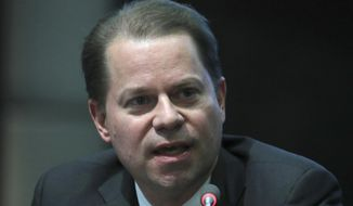FILE - In this file photo dated Thursday, Nov. 16, 2017, World Anti-Doping Agency (WADA) director general Olivier Niggli speaks to the media  in Seoul, South Korea.  During an interview published Monday Oct. 22, 2018, Niggli told The Associated Press it was now more beneficial to work with Russia to clean up sport, rather than forcing the government to confess to orchestrating the abuse of drugs and cover-ups.  (AP Photo/Lee Jin-man, FILE)