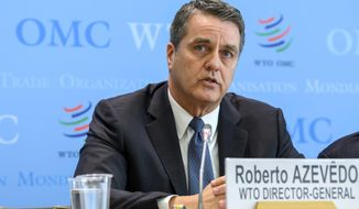 FILE - In this April 12, 2018 file photo Brazilian Roberto Azevedo, Director General of the World Trade Organization, WTO, speaks during a press briefing about the WTO's World Trade Report 2017 at the headquarters of the World Trade Organization, WTO, in Geneva, Switzerland. As it stands, the WTO is on track to become powerless by next year if the Trump administration continues to withhold support over its complaints that China breaks the rules.  (Martial Trezzini/Keystone via AP, file)