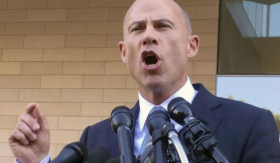 In this Sept. 24, 2018, file photo, Michael Avenatti, attorney for porn actress Stormy Daniels, talks to reporters after a federal court hearing in Los Angeles. A California judge on Monday, Oct. 22, ordered Avenatti to pay $4.85 million to an attorney at his former law firm--the first time the potential presidential candidate is being held personally liable in the case. (AP Photo/Amanda Lee Myers) **FILE**
