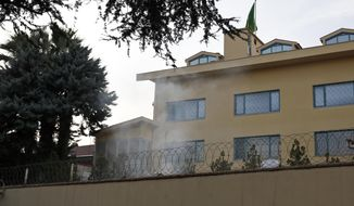 "In this photo taken on Wednesday, Oct. 3, 2018, white smoke billows from the courtyard of Saudi Arabia's consulate in Istanbul. A video shared by a television channel that is close to Turkey's government broadcasted on Monday, Oct. 22, 2018 appears to show three men burning documents at the Saudi Consulate's backyard a day after Saudi writer Jamal Khashoggi was killed. A Haber news channel said the surveillance camera video - allegedly showing ""evidence"" being burned inside a drum - was recorded on Oct. 3. (AP Photo/Lefteris Pitarakis)"