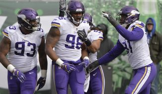 Minnesota Vikings defensive tackle Tom Johnson (96) celebrates with teammates Sheldon Richardson (93) and Stephen Weatherly (91) after tackling New York Jets' Isaiah Crowell near the goal line during the first half of an NFL football game Sunday, Oct. 21, 2018, in East Rutherford, N.J. (AP Photo/Howard Simmons)