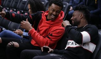 Denver Broncos' Demaryius Thomas, left and Emmanuel Sanders, right laugh on the court before the start of an NBA basketball game between the Denver Nuggets and the Golden State Warriors, Sunday, Oct. 21, 2018, in Denver. (AP Photo/Jack Dempsey)