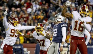 Washington Redskins defensive tackle Caleb Brantley (99), Washington Redskins defensive back Greg Stroman (37), and Washington Redskins wide receiver Jehu Chesson (16) celebrate after Dallas Cowboys kicker Brett Maher (2) misses a field goal at the end of regulation of an NFL football game to lose the game 20-17, Sunday, Oct. 21, 2018, in Landover, Md. (AP Photo/Andrew Harnik) **FILE**