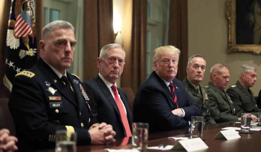 President Donald Trump, with (from left) Chief of Staff of the Army Gen. Mark Milley, Defense Secretary Jim Mattis, Trump, Chairman of the Joint Chiefs of Staff Gen. Joseph Dunford and Marine Corps Commandant Gen. Robert Neller, listen to questions from the members of the media during a briefing with senior military leaders in the Cabinet Room at the White House in Washington, Tuesday, Oct. 23, 2018. (Associated Press) **FILE**
