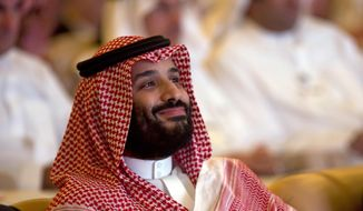 Saudi Crown Prince, Mohammed bin Salman, smiles as he attends the Future Investment Initiative conference, in Riyadh, Saudi Arabia, Tuesday, Oct. 23, 2018. The high-profile economic forum in Saudi Arabia is the kingdom's first major event on the world stage since the killing of writer Jamal Khashoggi at the Saudi Consulate in Istanbul earlier this month. (AP Photo/Amr Nabil)