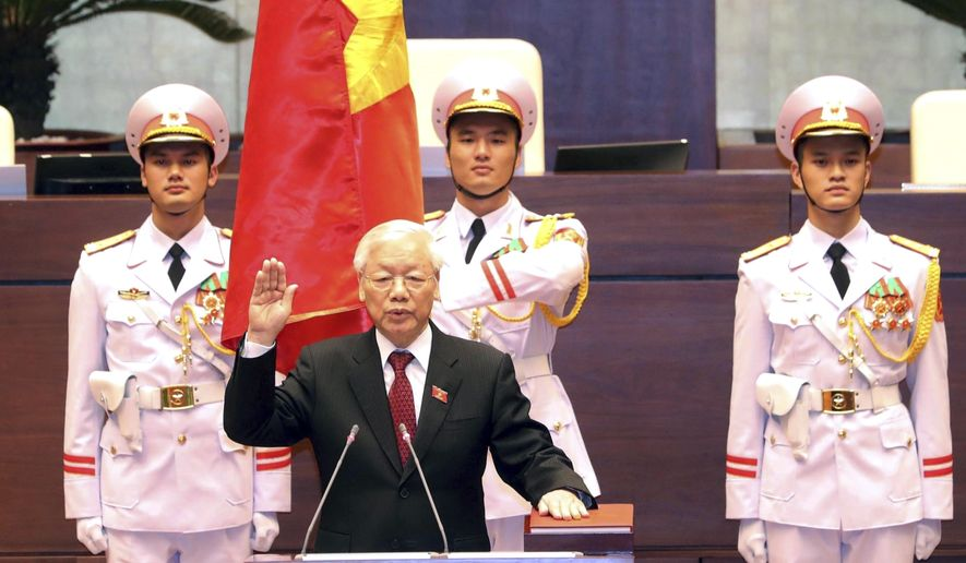 Vietnam's Communist Party General Secretary Nguyen Phu Trong is sworn in as the country's president in Hanoi, Vietnam, Tuesday, Oct. 23, 2018. The 74-year-old Trong was elected president by the National Assembly succeeding thelate President Tran Dai Quang who died last month after battling a viral illness for more than a year. (Nguyen Phuong Hoa/ Vietnam News Agency via AP)