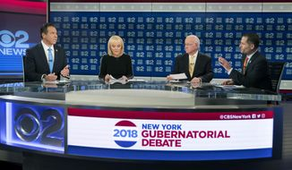New York Gov. Andrew Cuomo, left, and Republican gubernatorial candidate Marc Molinaro, right, argue during the New York gubernatorial debate hosted by CBS 2 chief political correspondent Marcia Kramer, second from left, and WCBS Newsradio 880 reporter Rich Lamb, Tuesday, Oct. 23, 2018, in New York. (AP Photo/Mary Altaffer, Pool)