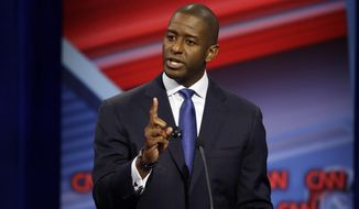 Florida Democratic gubernatorial candidate Andrew Gillum speaks during a CNN debate against his Republican opponent Ron DeSantis, Sunday, Oct. 21, 2018, in Tampa, Fla. (AP Photo/Chris O'Meara)