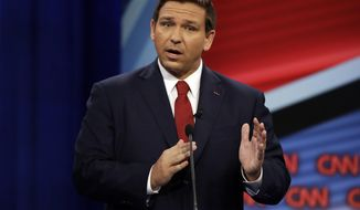 Florida Republican gubernatorial candidate Ron DeSantis speaks during a CNN debate against his Democratic opponent Andrew Gillum, Sunday, Oct. 21, 2018, in Tampa, Fla. (AP Photo/Chris O'Meara)