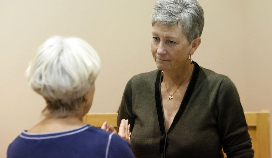 Grand Canyon National Park Superintendent Christine Lehnertz, right, speaks with a member of the public at an October, 2017 event at the Museum of Northern Arizona in Flagstaff, Ariz. The National Park Service says Lehnertz will be reassigned temporarily while a federal watchdog investigates undisclosed allegations. (Benji Shanahan/Arizona Daily Sun via AP)