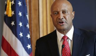 FILE - In this July 9, 2018, file photo, Indiana Attorney General Curtis Hill speaks during a news conference at the Statehouse in Indianapolis. Fort Wayne attorney Daniel Sigler, a special prosecutor who helped investigate allegations that Hill drunkenly groped a lawmaker and three legislative staffers, is planning an announcement Tuesday, Oct. 23, 2018, in Indianapolis on that investigation. (AP Photo/Michael Conroy, File)